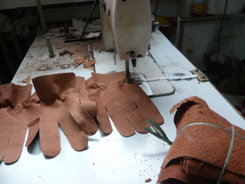 Unfinished dog-leather gloves on the stitching table (2)
